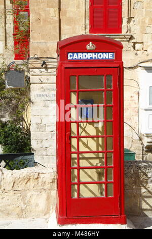 Traditional english red phone booth in Valletta, Malta - Stock Photo