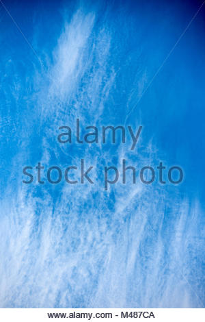 Beautiful blue sky with scattered clouds on a summer day - Stock Photo