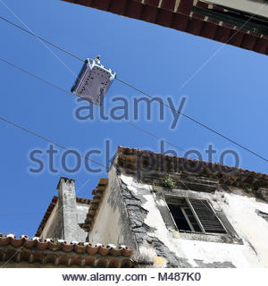 Cable car in the old city of Funchal on Madeira - Stock Photo