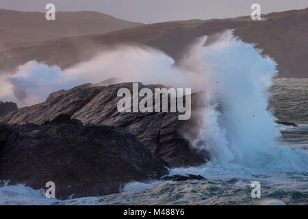 Storm waves beneath Clare Island lighthouse, Achill Island, County Mayo, Ireland. - Stock Photo