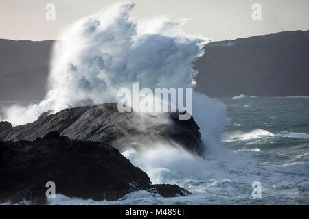 Storm waves beneath Clare Island lighthouse, Achill Island, County Mayo, Ireland. - Stock Photo