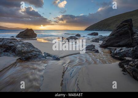 Winter sunrise over Keem Beach, Achill Island, County Mayo, Ireland. - Stock Photo
