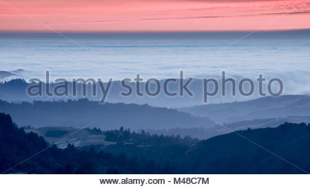 Rolling Hills Sunset Misty Mountains and Forest - Stock Photo