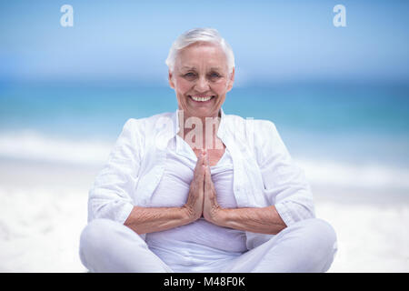 Beautiful mature woman posing with hands joined