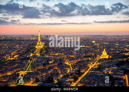 View over Paris with the Tour Eiffel after sunset - Stock Photo