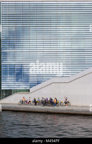 Group of young tourists on a bike tour in Berlin - Stock Photo