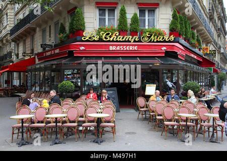 PARIS, FRANCE - JULY 21, 2011: Le Champ de Mars cafe in Paris, France. Le Champ de Mars cafe is a typical establishment - Stock Photo