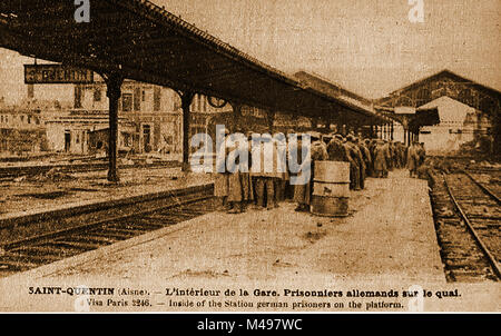 WWI - German prisoners of War on the railway station platform at Saint-Quentin, Aisne, France - Stock Photo