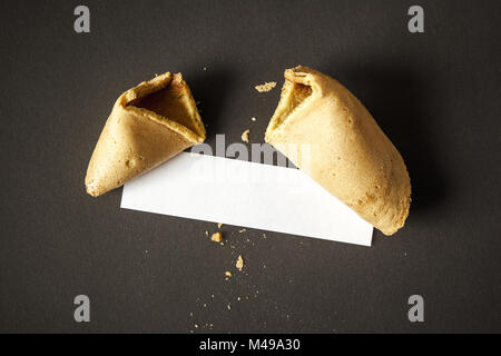a fortune cookie with a blank paper for your message - Stock Photo
