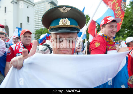 Euro 2012. Warsaw, Poland. 12th June 2012. Russian fans march to the Polish National Stadium before the Poland  - Stock Photo