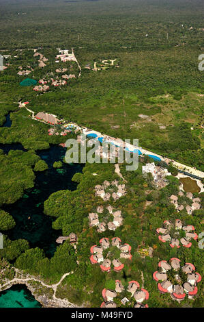 Aerial view of the tourist resorts and cenotes - freshwater holes - located all over the Yucatan peninsula, Mexico - Stock Photo