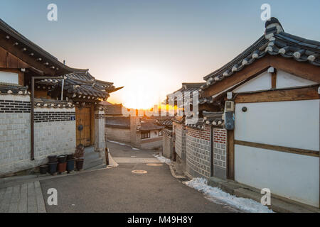 Sunrise in the morning with view of Bukchon Hanok Village in Seoul, Korea. - Stock Photo