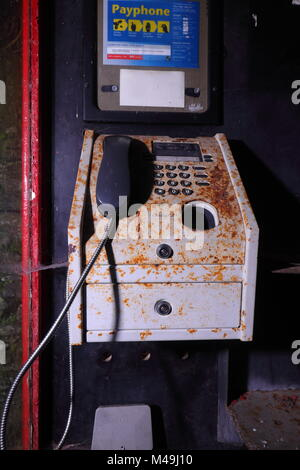 A public payphone inside a K8 type Telephone Box located on a caravan park in Ingleton, North Yorkshire - Stock Photo