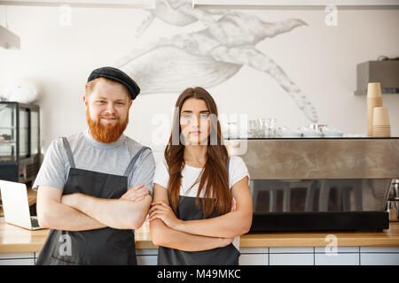 Coffee Business Concept - Portrait of small business partners standing together at their coffee shop  - Stock Photo