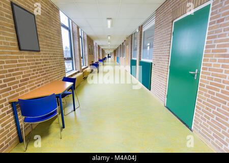 Long empty corridor in college school building - Stock Photo