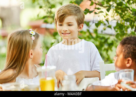 Boy and other kids in kindergarten on a kids birthday - Stock Photo