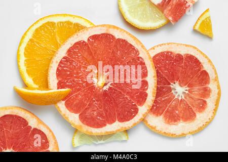 Mix fresh sliced orange, lemon and grapefruit - Stock Photo