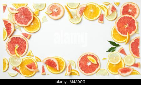 citrus fruit frame of  slices isolated on white background - Stock Photo