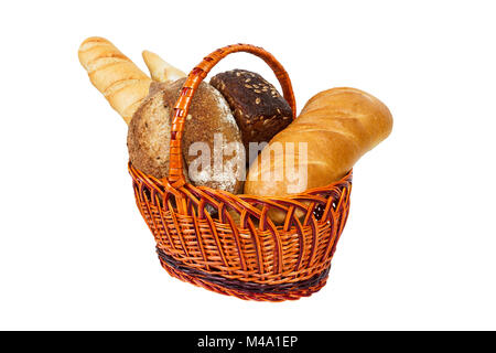 Fresh bread with wheat in wicker basket isolated on white. - Stock Photo