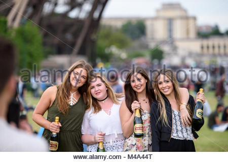 Best friends visiting Paris Eiffel Tower taking photo - Stock Photo