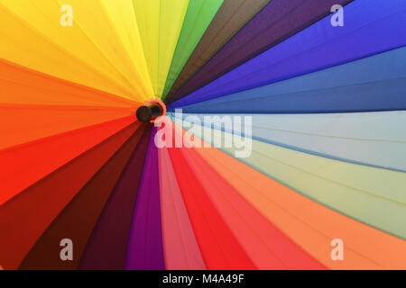 Bright umbrella with rainbow colors closeup - Stock Photo