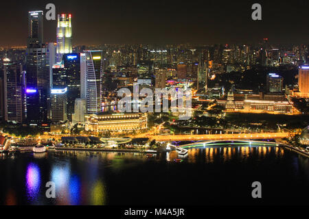 Singapore Downtown Core reflected in the river - Stock Photo
