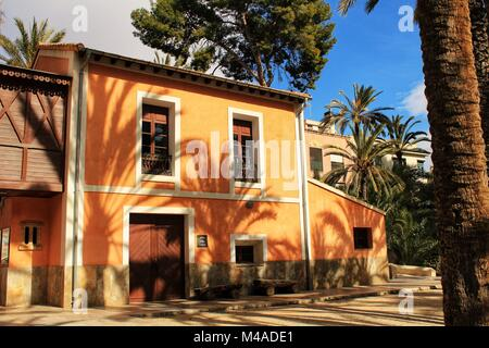 Elche, Spain- 14 February, 2018: Typical and colorful house in a palm orchard in Elche, Spain on a sunny day. Huerto - Stock Photo