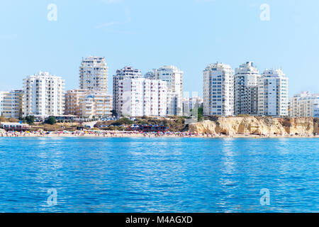 View from the sea to the apartments of Armacao de Pera and Praia do Vale do Olival beach , Algarve Portugal - Stock Photo
