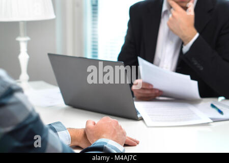 Job interview or meeting with bank worker in office. Business man considering. Discussion about loan, mortgage or - Stock Photo