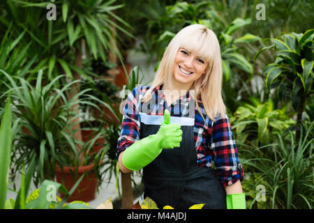 Lovely happy young woman gardener  - Stock Photo