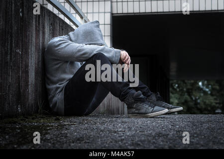 Depression, social isolation, loneliness, mental health and discrimination concept. Sad, lonely, depressed and unhappy - Stock Photo