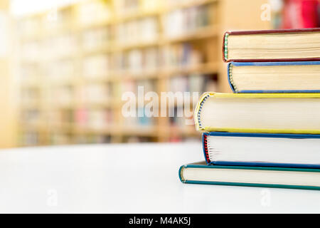 Stack and pile of books on table in public or school library. Education, studying and literature service concept - Stock Photo