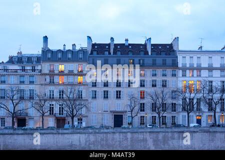 Facades of apartment buildings on Ile Saint Louis, Paris, France - Stock Photo
