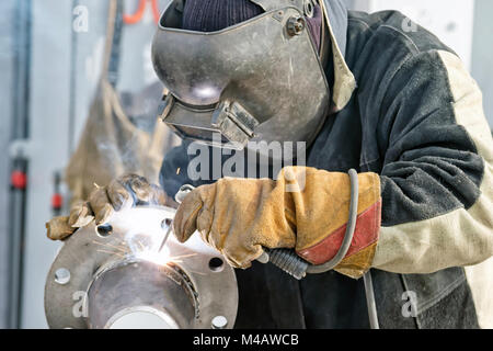 Welding works on manufacturing of units and parts of pipelines - Stock Photo
