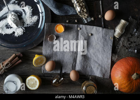 Ingredients for pumpkin pie on the wooden table - Stock Photo