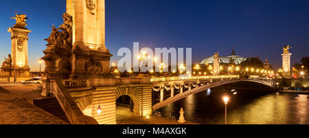 Panoramic view of the Pont Alexandre III Bridge illuminated at night with Seine River. 8th Arrondissement, Paris, - Stock Photo