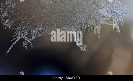 Winter patterns of ice on the window glass - macro - Stock Photo