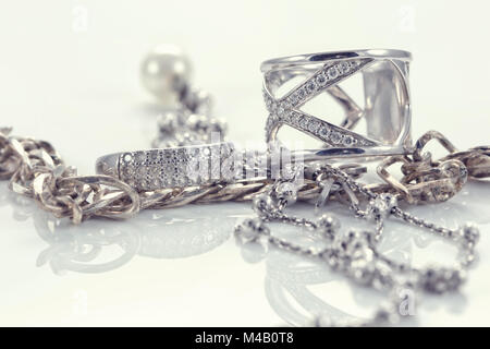 Silver ring with precious stones and fine silver chain - Stock Photo