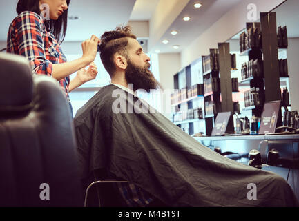 Handsome bearded man in the barbershop. - Stock Photo