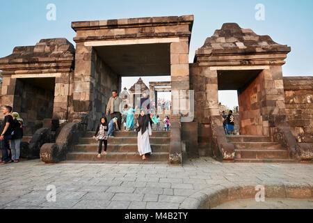 Visitors at the main gate of Ratu Boko Palace compound. Special Region of Yogyakarta, Java, Indonesia. - Stock Photo