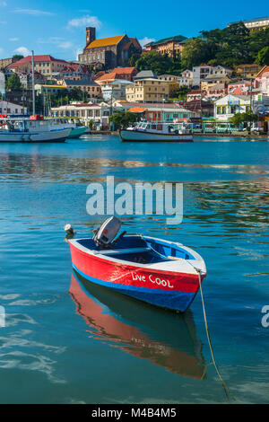 Little motoboat in the inner harbour of St Georges,capital of Grenada,Caribbean - Stock Photo