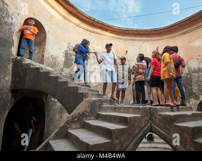 People in Gumuling Well (Sumur Gumuling), one-storeyed circular structure, once used as a mosque. Taman Sari Water - Stock Photo