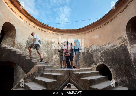 Tourists in Gumuling Well (Sumur Gumuling), one-storeyed circular structure, once used as a mosque. Taman Sari Water - Stock Photo