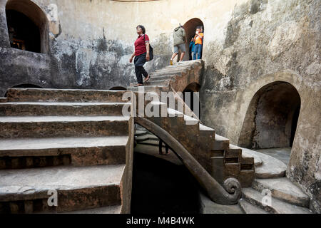 Woman in Gumuling Well (Sumur Gumuling), one-storeyed circular structure, once used as a mosque. Taman Sari Water - Stock Photo