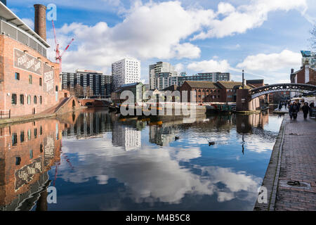Views of the canal with reflections of people and buildings in Brindley Place Birmingham, UK - Stock Photo