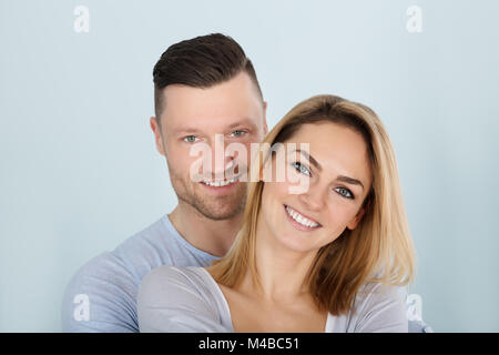 Portrait Photo Of An Smiling Young Couple - Stock Photo