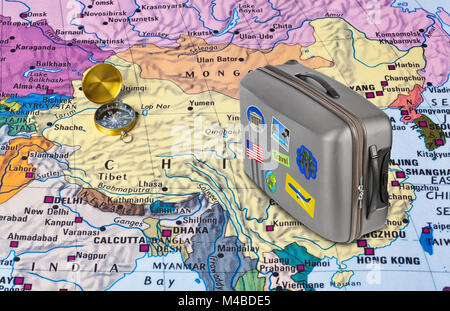 China map and travel case with stickers (my photos) - Stock Photo