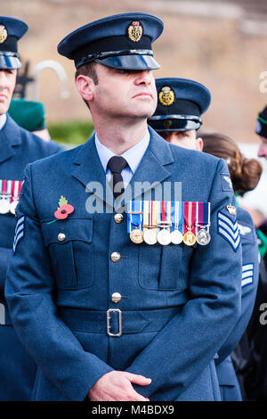 England, Ramsgate. Remembrance Sunday. RAF midadult man in blue uniform standing at ease with medals and poppy on - Stock Photo