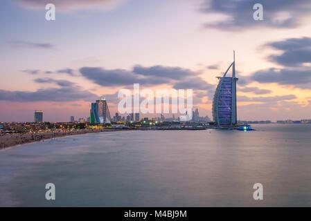 Burj Al Arab and Jumeirah Beach Hotel at the sunset - Stock Photo