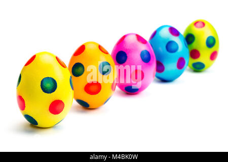 Painted easter eggs in row on white background - Stock Photo